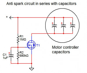 Anti spark circuit in series with capacitors